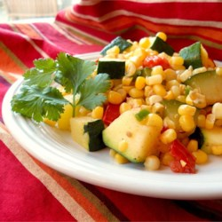 Calabacitas con Elote (Zucchini with Corn) Recipe - This mixture of zucchini, corn, tomatoes, and poblano pepper can be served as a side dish or eaten with warm tortillas as a main course.