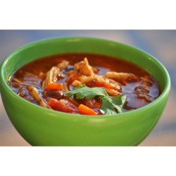 Catherine's Spicy Chicken Soup Recipe and Video - A shredded chicken soup flavored with garlic, onion powder, salsa, tomatoes, tomato soup, chili powder, corn, beans and sour cream.