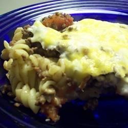 Husband's Delight Recipe - This ground beef casserole is layered with egg noodles and a mixture of sour cream, cream cheese, and onions, then topped with cheddar and baked.