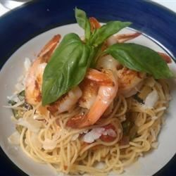 Angel Hair Pasta with Shrimp and Basil Recipe - If you like the ingredients in the name, you'll love the dish. Freshly grated Parmesan cheese makes it complete.