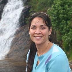 Lisa by waterfall in Isle of Skye