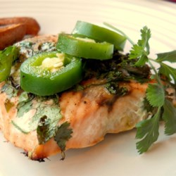 Grilled Salmon with Cilantro Sauce Recipe - Grilled salmon topped with cilantro, jalapeno, and butter.