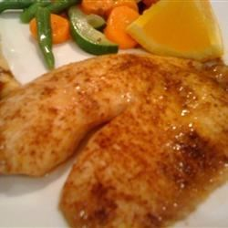Orange-Chile Tilapia Recipe - Tilapia fillets are rubbed with a hot spice mix, sprinkled with orange zest, and baked. I serve these with chili garlic sauce as a dip.