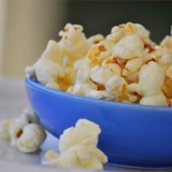 Kettle Corn Recipe and Video - White sugar makes the Kettle Corn taste like popcorn balls. Use brown sugar and it will taste like caramel corn.