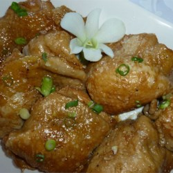 Adobo Chicken with Ginger Recipe - This is considered the Philippine national dish. The combination of soy sauce, vinegar, garlic, ginger and peppercorns is delicious and actually preserves the chicken! Great for picnics.  My mother taught me how to cook this, using her variation from the original recipe. A delicious, cheap and easy dish! Serve it hot with hot steamed Jasmine rice.