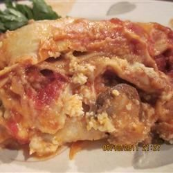Italian Sausage and Mushroom Lasagna with Bechamel Sauce Recipe - The bechamel adds a little something special to this wonderful lasagna, made with Italian sausage, brown cremini mushrooms, and plenty of marinara sauce and cheese.