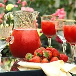"Virgin Strawberry Daiquiri Recipe - Grenadine, sweet-and-sour mix, plus a handful of ripe, ripe berries puts this ""safe"" cocktail in the pink."