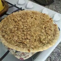Pear Sour Cream Pie Recipe - Fresh ripe pears are baked in a vanilla-sour cream custard and topped with an oat crumble in this delicious pie.