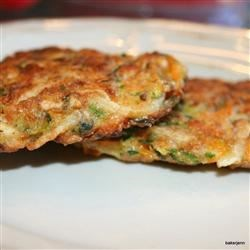 Vegetable and Feta Latkes Recipe - Try this colorful take on traditional potato pancakes. Stir shredded zucchini, potatoes and carrots into a batter of eggs, matzo meal, parsley and feta cheese. Fry until golden brown. You'll love the creamy bite of feta with the tender veggie crunch.