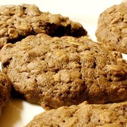 Cocoa Oatmeal Cookies Recipe - These delicious oatmeal-raisin cookies are made with cocoa for a chocolate version of a classic cookie style.