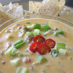 Sausage Cheese Dip Recipe - Sausage is mixed into a spicy, creamy cheese mixture to create a wonderful dip that always disappears fast at parties. Serve with tortilla chips.