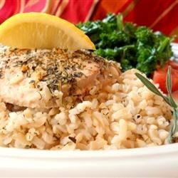 Baked Salmon I Recipe - Baked salmon with herbs, orange juice, and brown rice. Great served with steamed broccoli and carrots.