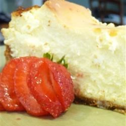SuzyQ's Elegant Cheesecake Recipe - This lovely, rich cheesecake has a hint of lemon flavor. Make it the day before, so it can bake and chill overnight. Then serve with your favorite topping.