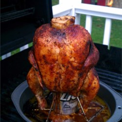 Beer Can Chicken Recipe - This delicious whole chicken is barbequed on top of an open beer can for added juiciness and flavor.