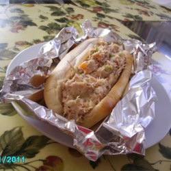 Tuna Coney Dogs Recipe - American cheese, hard-cooked eggs and tuna combine with pickles and olives to make a simple sandwich that adults and kids love.