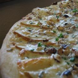 Pear and Gorgonzola Cheese Pizza Recipe - Here's an appetizer that's exciting and unique! Fresh pears and Gorgonzola cheese star as unlikely cohorts in this wildly delicious flavor extravaganza!