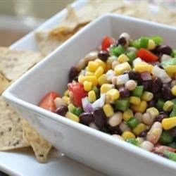 Texas Caviar I Recipe - Here's a spicy Texas favorite. Black-eyed peas and black beans are marinated in a fiery, flavorful mixture. This is great with tortilla chips or bread -- and plenty of cold iced tea!
