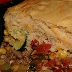 Saucy Beef and Vegetable Casserole Recipe - Ground beef (or ground turkey), shredded zucchini, spices, salsa, tomato soup, and corn are cooked with a garlic, sour cream, and Cheddar cheese biscuit topping. Even my toddler loves this recipe!