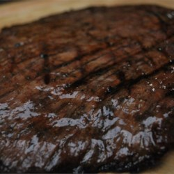 Flank Steak with a Port Wine Marinade Recipe - Flank steak is marinated in a port, citrus, and honey marinade before being grilled to perfection.