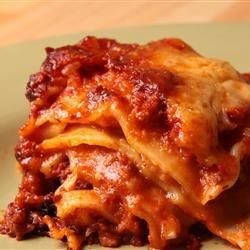 Slow Cooker Lasagna Recipe and Video - Start with a skillet and finish with a slow cooker. A saute of onion, garlic and ground beef is simmered with tomato and oregano, then layered in a slow cooker with raw lasagna noodles and a creamy blend of cottage cheese, Parmesan and mozzarella.