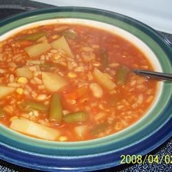 Quick and Easy Vegetable Soup Recipe - This tasty homemade vegetable soup recipe with a tomato base features potatoes, green beans, and carrots for a quick and easy meal.
