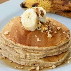 Whole Wheat, Oatmeal, and Banana Pancakes Recipe - Wholesome oat and whole wheat banana pancakes will bake up light and fluffy. The secret is letting the pancake batter rest for 5 minutes.