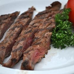 London Broil II Recipe and Video - A quick fix for an inexpensive cut of meat. Mix up soy sauce, vegetable oil, ketchup, oregano and one whole clove of garlic, then marinate the meat overnight.
