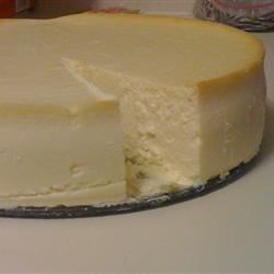 Eric's Best New York Style Cheesecake Recipe - This rich crustless cheesecake is flavored with amaretto rather than the traditional lemon. Serve with fresh sliced fruit or berries and fresh whipped cream.