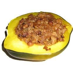 Acorn Squash with Sweet Spicy Sausage Recipe - This simple recipe combines the sweetness of winter squash and brown sugar with spicy turkey sausage, all served right in the squash shell.