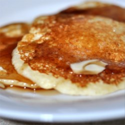 International Pancakes Recipe - These buttermilk griddle cakes are light and fluffy, and go down so easy with butter and syrup.