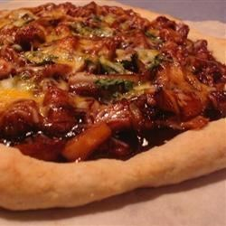 BBQ Chicken Pizza I Recipe - This is an easy not-too-sweet, delicious alternative to tomato sauce based pizzas! Sure to satisfy everyone. Use any kind of barbeque sauce and it will still be a winner!