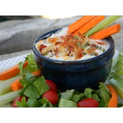 Spiced-Up Ranch Dip Recipe - Chili powder and cayenne pepper add heat to this sour cream-based ranch dip with bacon bits and Cheddar cheese.