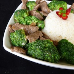 Broccoli Beef I Recipe - Sliced steak and broccoli are quickly cooked in a soy-ginger sauce. Serve over hot rice or noodles.