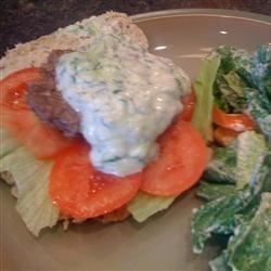 Grilled Gyro Burgers Recipe - Creamy cucumber sauce tops off these grilled burgers inside a pita pocket shell.