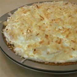 Coconut Cream Pie VII Recipe - This is a rich pie that 's made with evaporated milk, lots of milk and eggs, and plenty of coconut. The filling is cooked until thick and creamy, and it 's immediately poured into a baked pie shell and chilled.