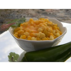 Hot Corn Recipe - Corn and jalapeno peppers are smothered with a sauce of cream cheese, butter and milk, topped with cheddar cheese and then baked.