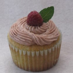 Raspberry Iced Tea Cupcakes Recipe - Delightful lemon cupcakes are filled with mint cream filling, then topped with a dollop of raspberry-tea flavored creamy frosting.