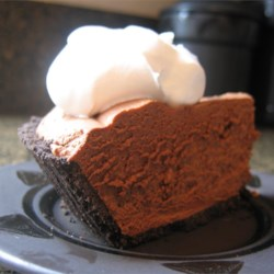 Rich Chocolate Truffle Pie Recipe - Semi-sweet chocolate is melted in rich heavy cream sweetened with confectioners ' sugar, and then spiked with vanilla. Whipped cream is folded into this already luscious filling and poured into a chocolate cookie crust. Chill and serve to raves.