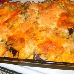 Easy Eggplant Dish Recipe - Eggplant and yellow squash are combined with onions, bread crumbs and green chiles, and baked with a cheesy cracker crust.