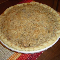 Crumb Apple Pie Recipe - Cinnamon and nutmeg are sprinkled between layers of sliced apples, covered with a sweet butter crumble concoction, and baked in a pie shell until the apples are tender and the juices are bubbling through the sugar crumble.