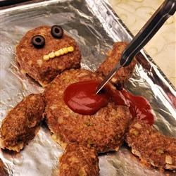 Dead Man Meatloaf Recipe - Traditional meatloaf made creepy. Kids love this. Be sure to feed them before they go trick-or-treating.