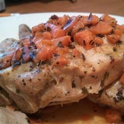 Pork Tenderloin with Creamy Herb Sauce Recipe - A wonderfully elegant and easy pork tenderloin dish with a creamy herbed wine sauce. Very rich, without all of the fat and calories!  Serve with garlic mashed potatoes.  A wonderful dish.