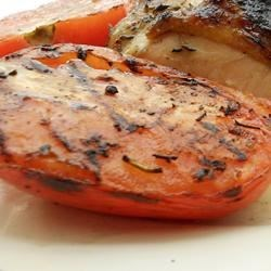 Grilled Tomatoes Recipe - Fresh summer tomatoes are simply drizzled with olive oil and sprinkled with garlic, salt, and black pepper before being grilled for a side dish that's perfect with just about anything off the grill.