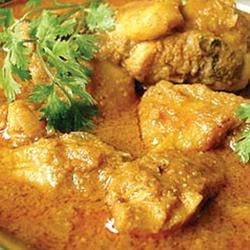 Burmese Chicken Curry Recipe - Chicken thighs are simmered with a fragrant mixture of curry powder, garam masala, lemon grass, tomatoes, and onions.