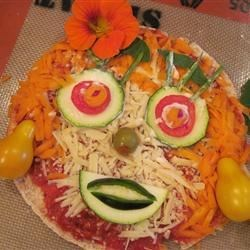 This pizza face was made by my 10 year old Granddaughter Rylea