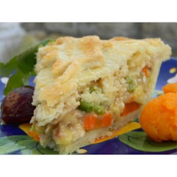Grandma Carlson's Turkey Pot Pie Recipe - With a flaky and tender homemade crust and a savory turkey filling loaded with fresh herbs and veggies, this handcrafted turkey pot pie will make you glad you have some leftover turkey meat.