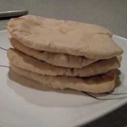 Pita Bread Recipe - This low-fat pita recipe calls for applesauce instead of oil.  Bake or fry it until puffy, and then let it cool and wrap it around your favorite sandwich fixings.