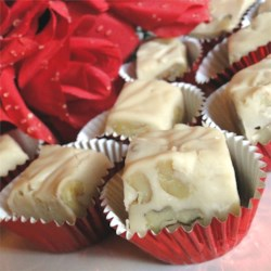Boardwalk Quality Maple Walnut Fudge Recipe - White chocolate is melted with sweetened condensed milk to make this classic maple-flavored treat.