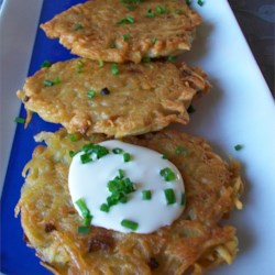 Potato Latkes I Recipe and Video - Shredded potatoes and grated onions are bound with flour, salt and eggs, then fried in oil to make delicious potato pancakes that are crispy on the outside and tender on the inside.
