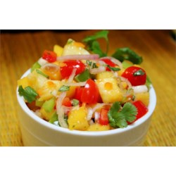 Apricot Salsa Recipe - The sweetness of fresh apricots and pineapple meets the heat of a minced habanero pepper to make a bright, colorful summer salsa.